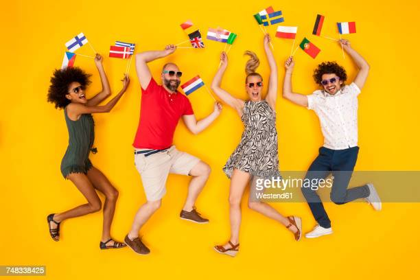 Group of people dancing and holding European flags