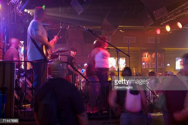 group of people dancing at a nightclub, new orleans, louisiana, usa - new orleans stock photos and pictures
