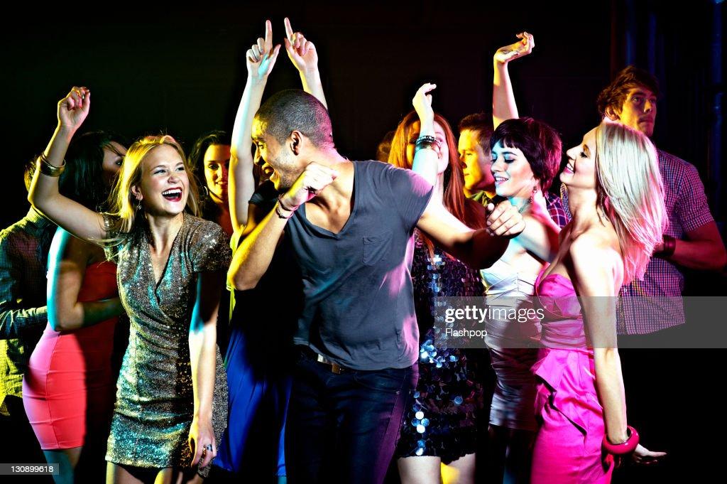 Group of people dancing at nightclub : Stock Photo
