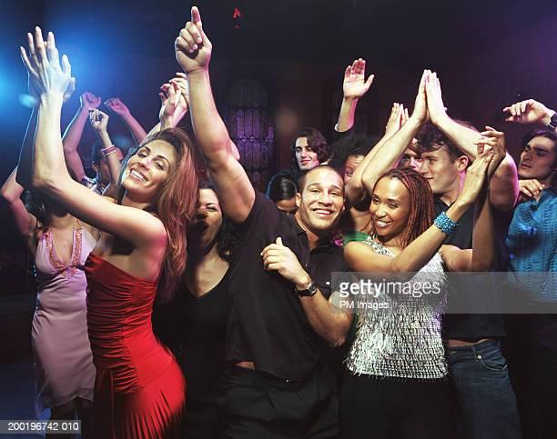 Group of people dancing in nightclub