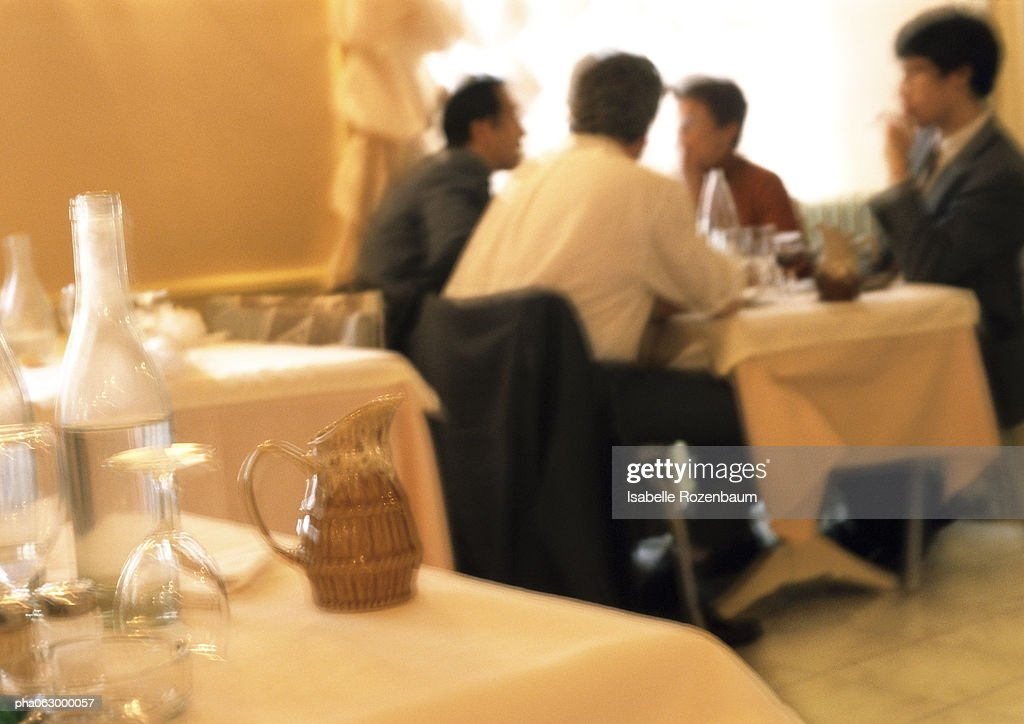 Group of people dining in restaurant, in background, blurred. : Stockfoto