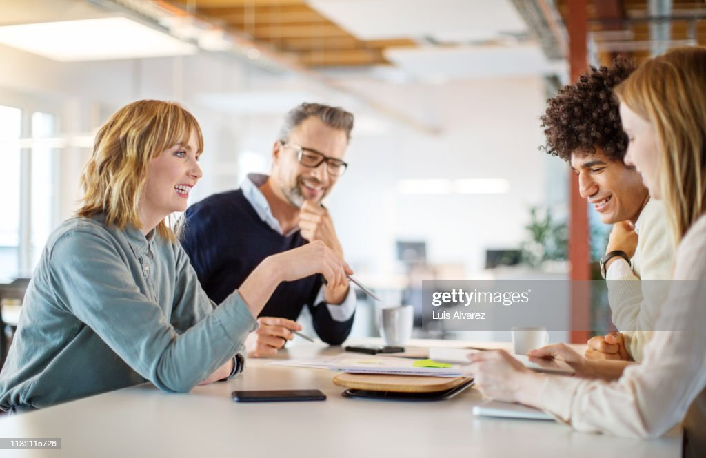 Group of people discussing business plan in office : Stock Photo