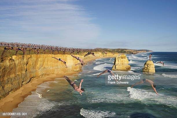 Group of people diving off cliffs into sea