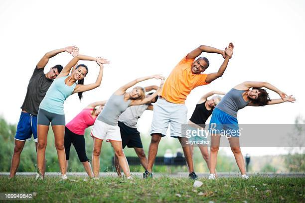 Group of people doing stretching exercises.