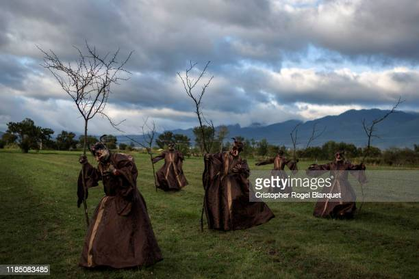 A group of people dressed as witches pose in a field in the town of Soledad Etla as part of the Deaths within the framework of the 'Day of the Dead'...