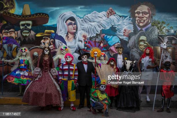 A group of people dressed up for the Day of the Dead parades pose as part of the 'Day of the Dead' celebrations on November 2 2019 in Oaxaca Mexico...