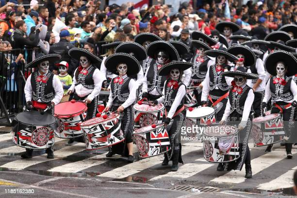 A group of people dressed up like Mariachi perform as part of the 'Day of The Dead' celebrations on November 02 2019 in Mexico City Mexico Every year...