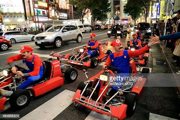 <A group of people dressing up as video game character Mario ride vehicles> on October 30 2015 in Tokyo Japan Tokyo metropolitan police is expected...