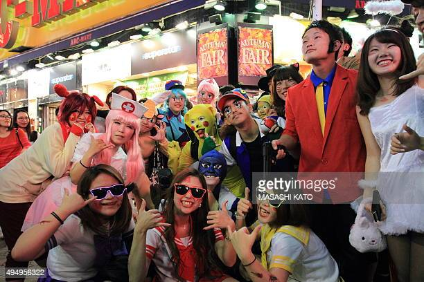<A group of people dressing up for Halloween gather and take photos> on October 30 2015 in Tokyo Japan Tokyo metropolitan police is expected to...