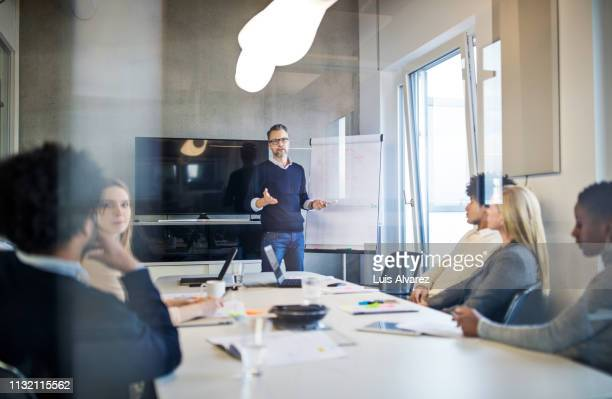 group of people during a presentation in modern office - marketing stock-fotos und bilder