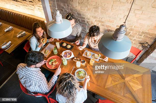 Group of people eating at a restaurant