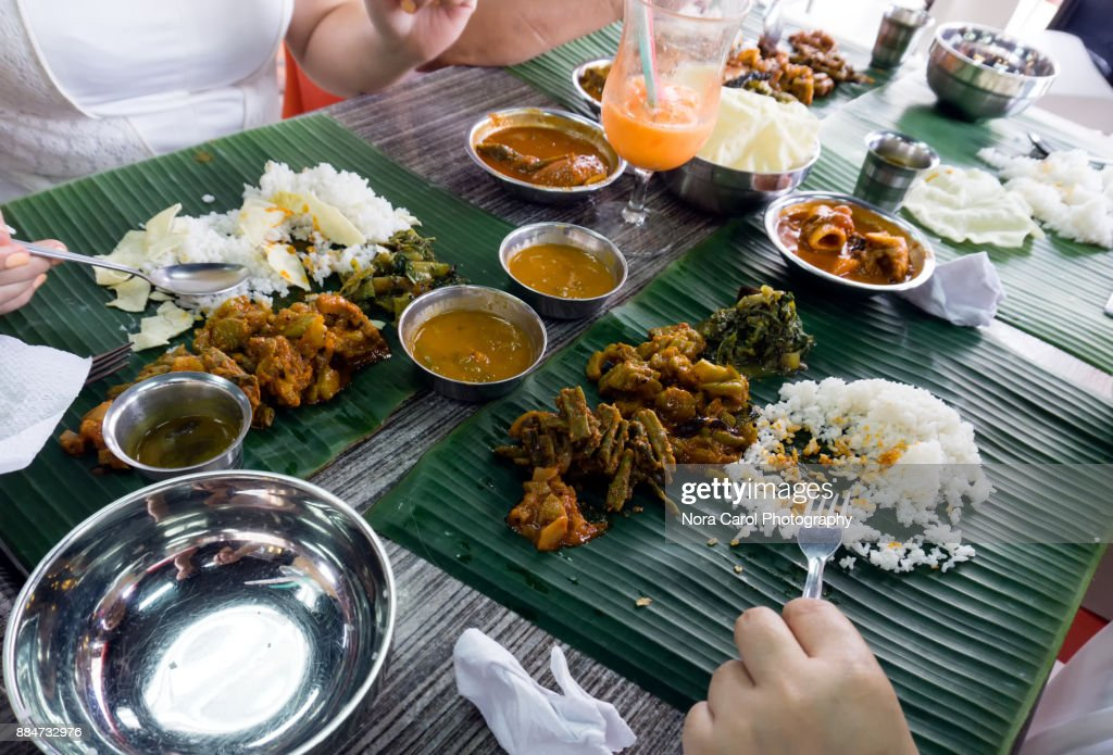 Group of People Eating Sadya or Banana Leaf Rice Indian Food. : Stock Photo