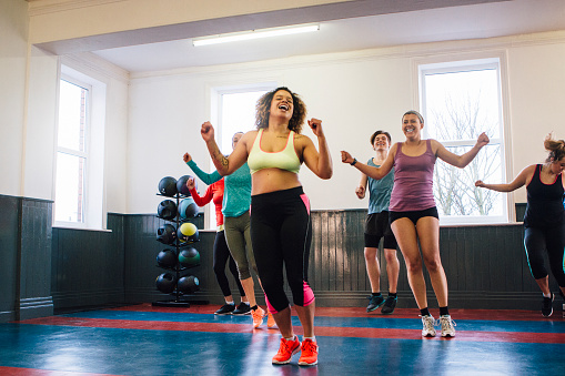 Group of People Enjoying an Exercise Class 619366650
