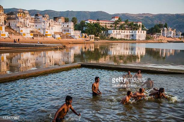 CONTENT] A group of people enjoying bath in the afternoon at Pushkar lake This lake is located in the town of Pushkar in Ajmer district of the...