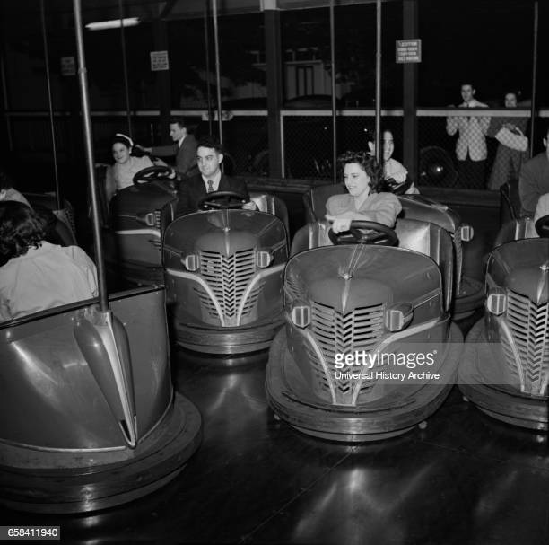 Group of People Enjoying Bumper Cars at Amusement Park Southington Connecticut USA Fenno Jacobs for Office of War Information May 1942