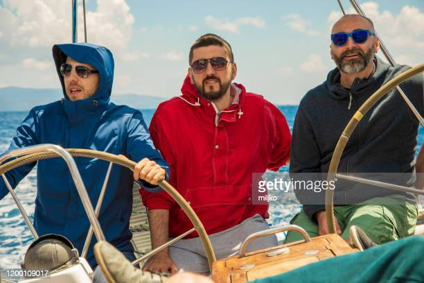 group of people enjoying on sailing - yachting stock pictures, royalty-free photos & images