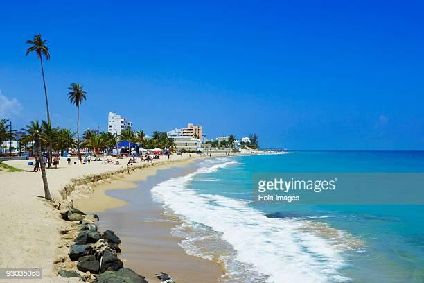 Group of people enjoying on the beach, San Juan, Puerto Rico