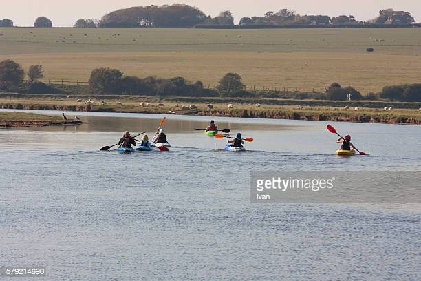 A Group of People Enjoying Rowing Boat Activity, Leisure in Day