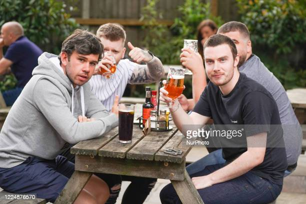 Group of people enjoying their first during the re-opening of pubs and bars in Sheffield, UK on 4 July 2020 as lockdown is eased across the `UK.