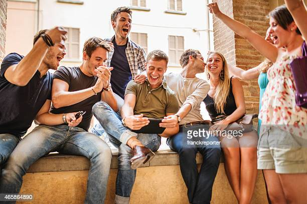 Group of people enjoying together with a tablet