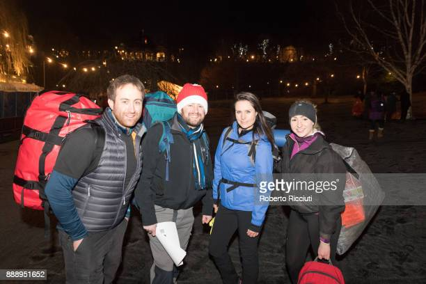 A group of people enter the sleeping outdoor area of Sleep In The Park a Mass Sleepout organised by Scottish social enterprise Social Bite to end...