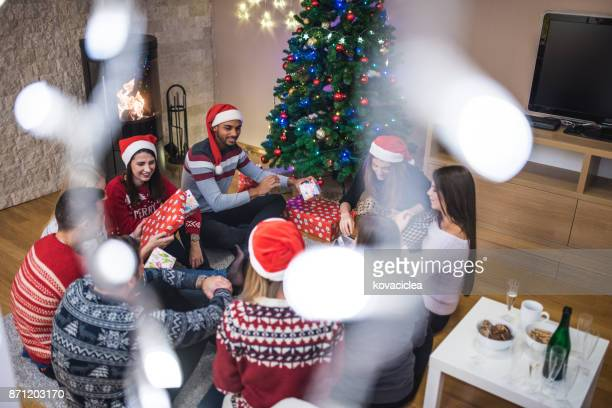Group of people exchanging gifts