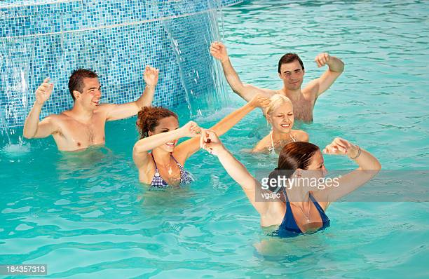 Group of people exercise aerobics in the pool