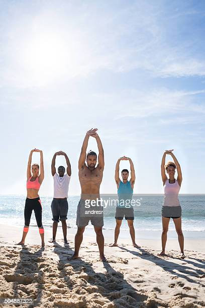 Group of people exercising at the beach