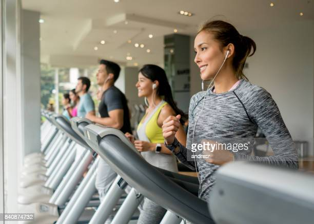 Group of people exercising at the gym on the treadmill