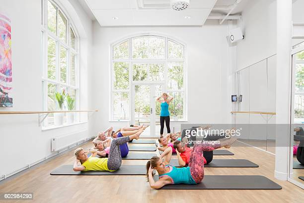 Group of people exercising in fitness class