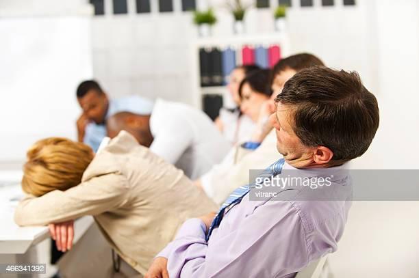 Group of people falling asleep in boring seminar