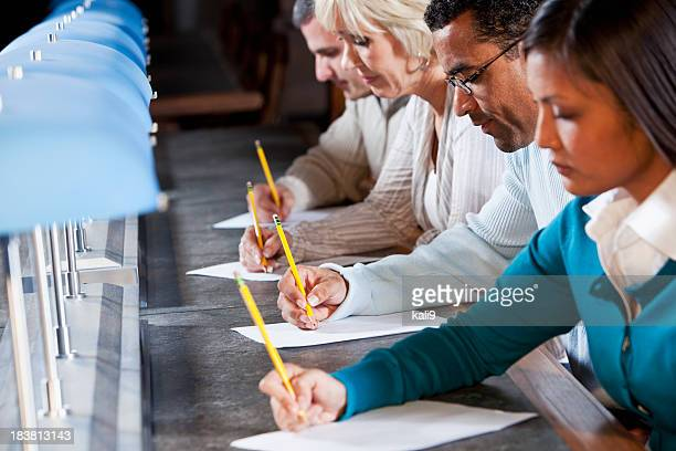 Group of people filling out paperwork