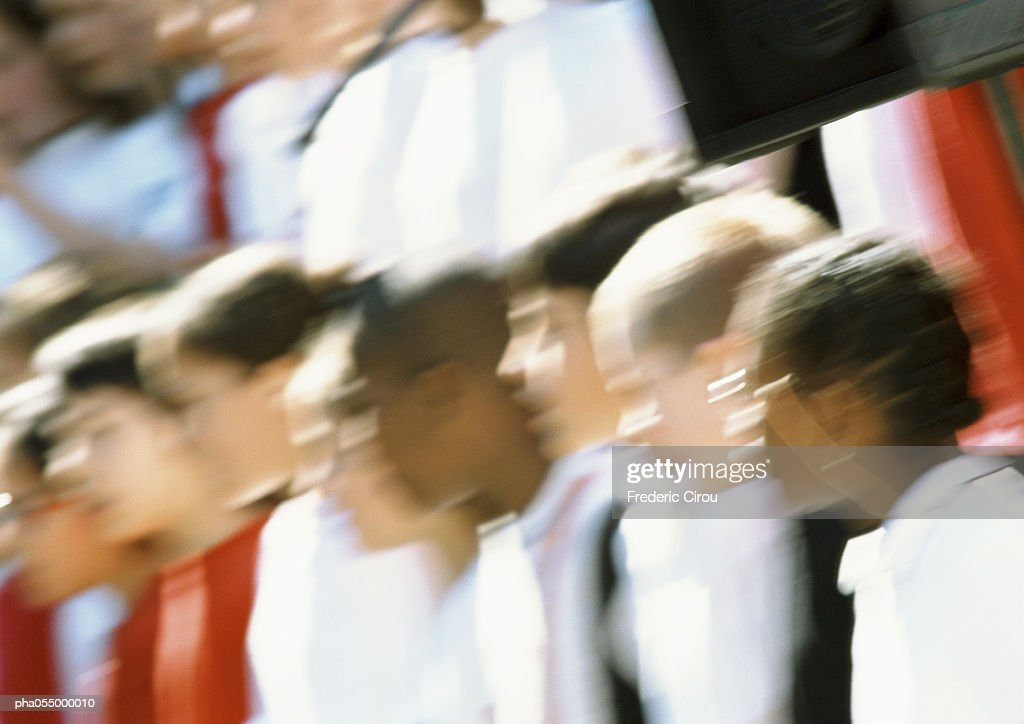 Group of people forming a line, head and shoulders, blurred : Stockfoto