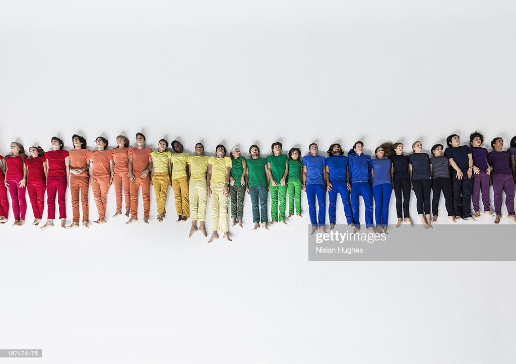 Group of People Forming a Rainbow on Studio Floor : Stock Photo