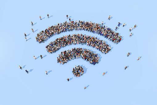 Group of people forming a wifi symbol 520835722