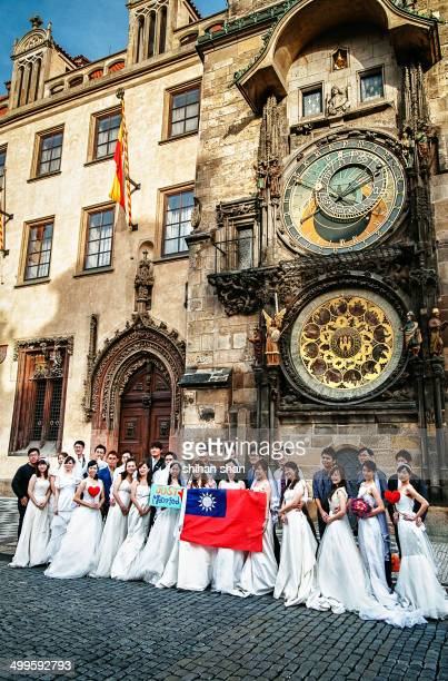 Group of people from Taiwan were having wedding ceremony in front of the Prague Astronomical Clock at old city square in Prague.