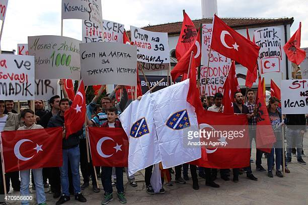 A group of people from varied nations hold Turkish Flags and banners as they shout slogan during a demonstration to show solidarity with Turkey...