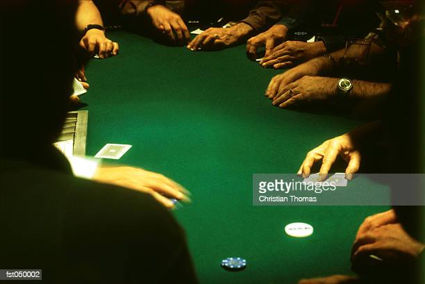 group of people gambling at a casino blackjack table