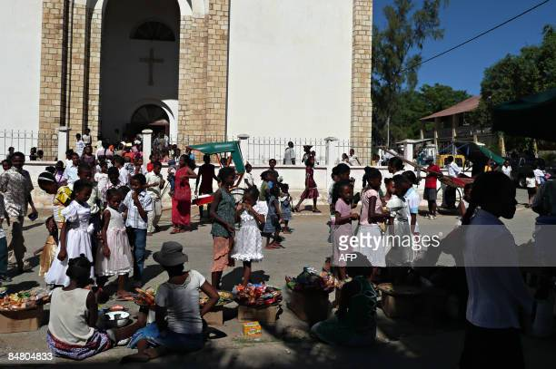 AUSEEILLA group of people gather after praying outside a Lutheran cathedral in the south west city of Toliara in Madagascar on February 15 2009...