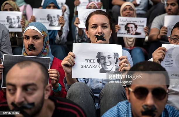 A group of people gather at Adeviyye Rabiatul square to demonstrate demanding the release of photojournalist Mahmoud Abou Zeid proffessionally known...