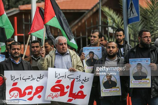 A group of people gather to protest against the cutting the stipends for Palestine martyrs detainees former prisoners and civil servants by the...