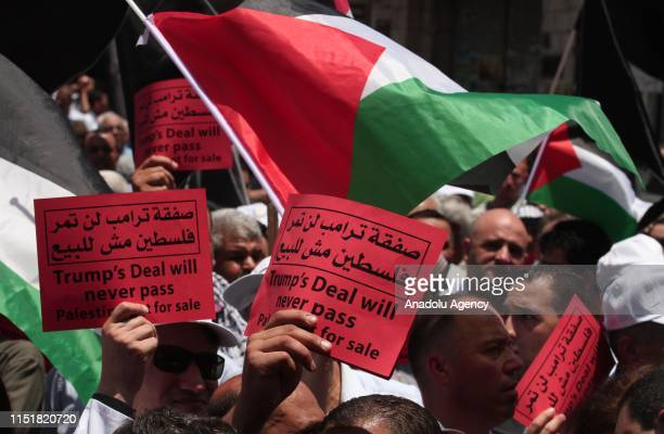 A group of people gather to protest against the USled conference in Bahrain on June 25 2019 in Nablus West Bank US officials are expected to unveil...