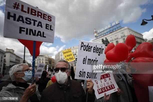 Group of people gather to support the law drafted at the initiative of the left coalition government and legalised the euthanasia in Madrid, Spain on...