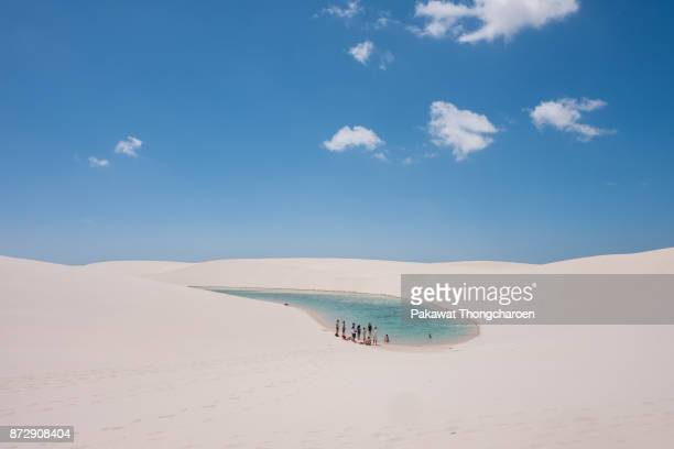 Group of People Gathering at Oasis, Lencois Maranhenses, Brazil