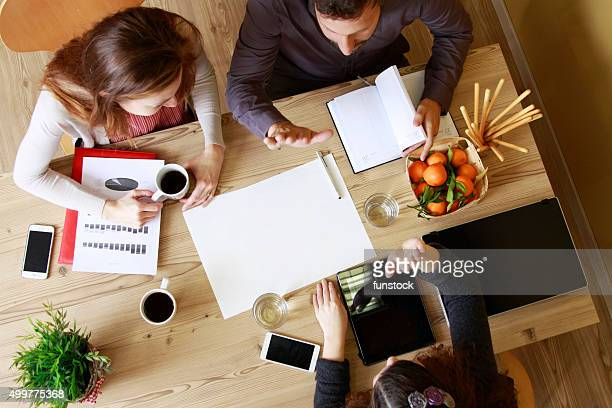 Group of people gathers having brainstorming for new strategies