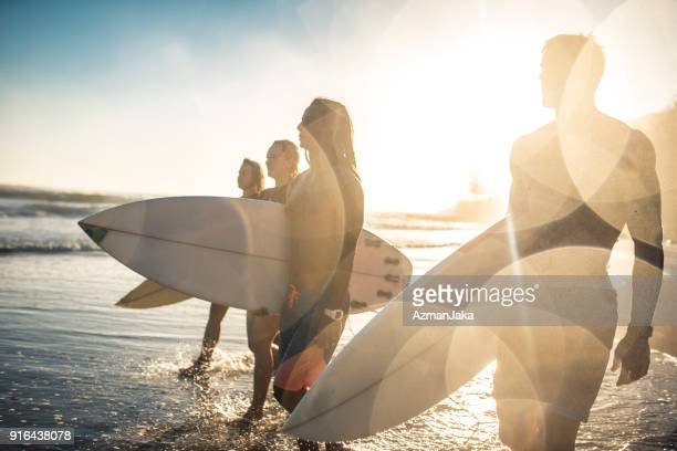 Group of people getting ready to surf