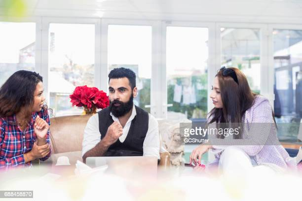 Group of people having a meeting at coffee shop