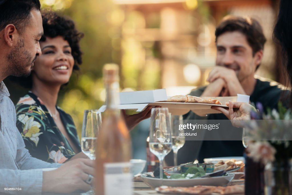 Group of people having a party outdoors : Stock Photo