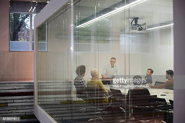 Group of people having business meeting in conference room