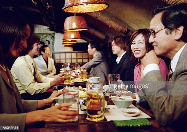 Group of people having dinner in restaurant